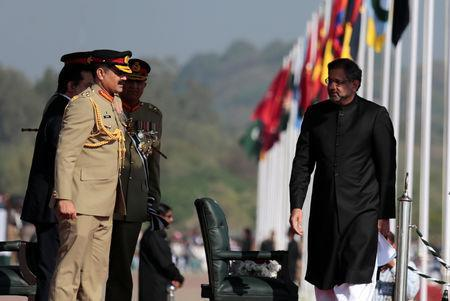 Prime Minister Shahid Khaqan Abbasi is greeted by the heads of armed forces as he arrives at the Pakistan Day military parade in Islamabad, Pakistan, March 23, 2018. REUTERS/Caren Firouz