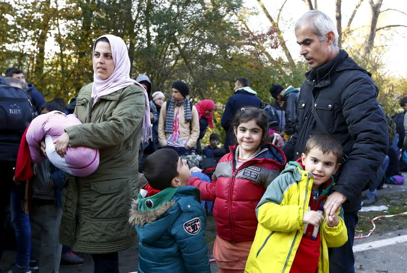 FILE PHOTO: Syrian migrants Khalil arrives with wife and children at the Austrian-German border in Achleiten near Passau