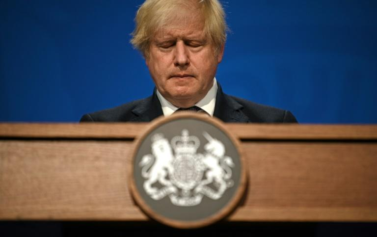 The report said Boris Johnson's government waited too long to lockdown in early 2020 (AFP/DANIEL LEAL-OLIVAS)