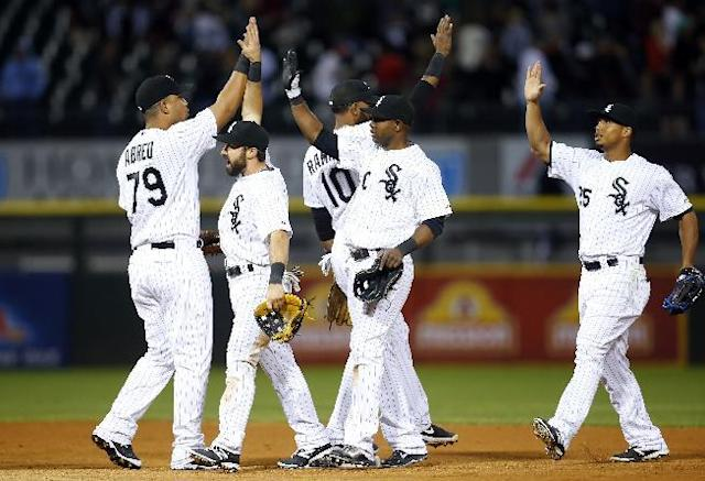 Members of the Chicago White Sox celebrate after beating the Detroit Tigers 6-5 in a baseball game on Monday, June 9, 2014, in Chicago. (AP Photo/Jeff Haynes)