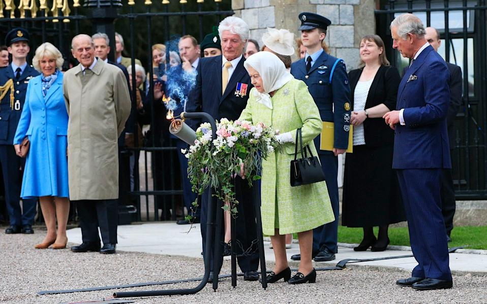 The Queen lit a series of birthday beacons, on the occasion of her 90th - PA