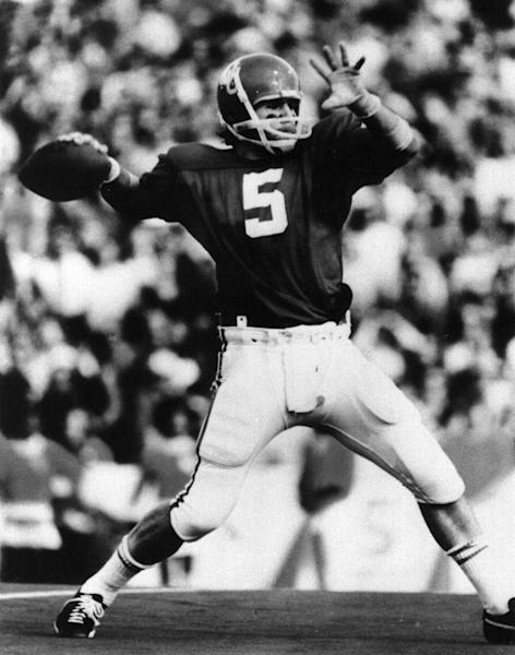 This undated photo provided by OU Athletics Communications shows quarterback Steve Davis passing the football. A University of Oklahoma official says the starting quarterback for Oklahoma's national championship teams in 1974 and 1975 is one of two men killed when a small plane slammed into a house in northern Indiana on Sunday, March 17, 2013. St. Joseph County Coroner Randy Magdalinski identified the victims of Sunday's crash as 60-year-old Steven Davis and 58-year-old Wesley Caves, both of Tulsa, Okla. (AP Photo/OU Athletics Communications)