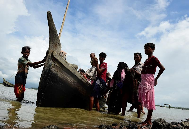 Rohingya Muslim refugees disembark from a boat on the Bangladeshi side of Naf river in Teknaf on September 12, 2017 (AFP Photo/MUNIR UZ ZAMAN)