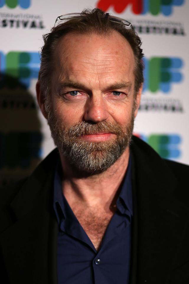 "MELBOURNE, AUSTRALIA - AUGUST 03: Actor Hugo Weaving poses as he arrives at the world premiere of ""The Turning"" at Greater Union Cinemas on August 3, 2013 in Melbourne, Australia. (Photo by Graham Denholm/Getty Images)"