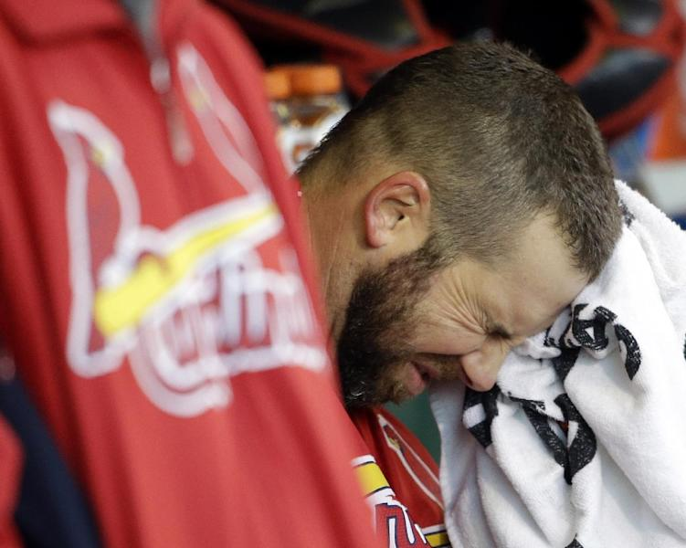 FILE - In this Oct. 21, 2012, file photo, St. Louis Cardinals' Chris Carpenter wipes his face with a towel in the dugout during the fourth inning of Game 6 of baseball's National League championship series against the San Francisco Giants in San Francisco. Carpenter is unlikely to pitch for the Cardinals this season and his career may be over because of a nerve injury that kept him out most of last year, general manager John Mozeliak said Tuesday, Feb. 5, 2013. (AP Photo/David J. Phillip, File)