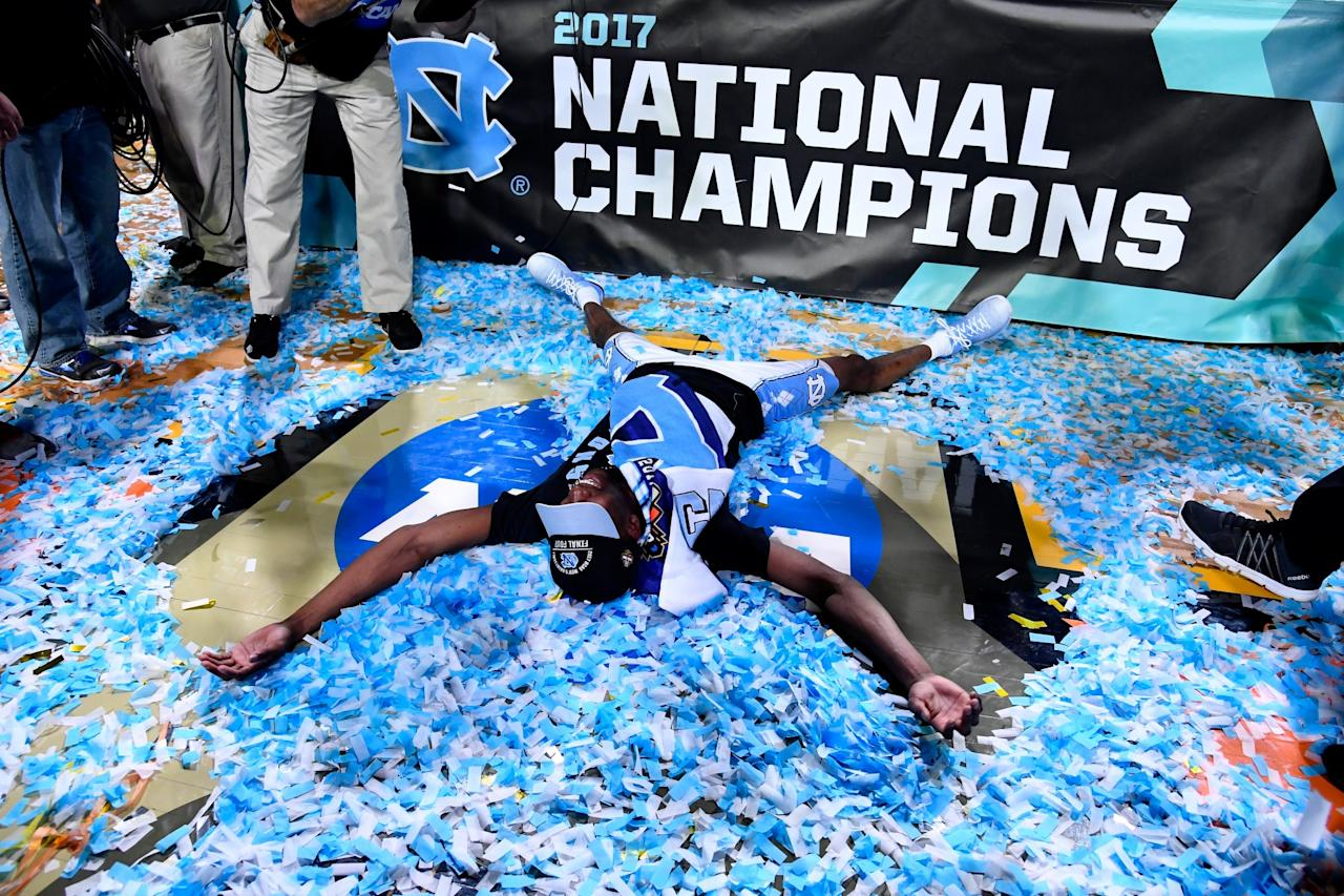 <p>Theo Pinson #1 of the North Carolina Tar Heels makes a confetti angel after time expired during the 2017 NCAA Men's Final Four National Championship game against the Gonzaga Bulldogs at University of Phoenix Stadium on April 3, 2017 in Glendale, Arizona. (Photo by Brett Wilhelm/NCAA Photos via Getty Images) </p>