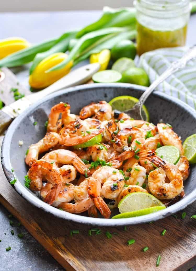 """<p>Shellfish is a great source of lean protein and healthy fats to fill you up and promote weight loss. It's also an easy weeknight meal to get together fast, and this grilled shrimp recipe by<a href=""""https://www.theseasonedmom.com/grilled-honey-lime-shrimp/"""" rel=""""nofollow noopener"""" target=""""_blank"""" data-ylk=""""slk:The Seasoned Mom"""" class=""""link rapid-noclick-resp""""> The Seasoned Mom</a>, once marinated, takes only 10 minutes to cook. And have some fun with flavor—this blogger uses garlic, chives, honey, lime, and Dijon mustard.</p>"""