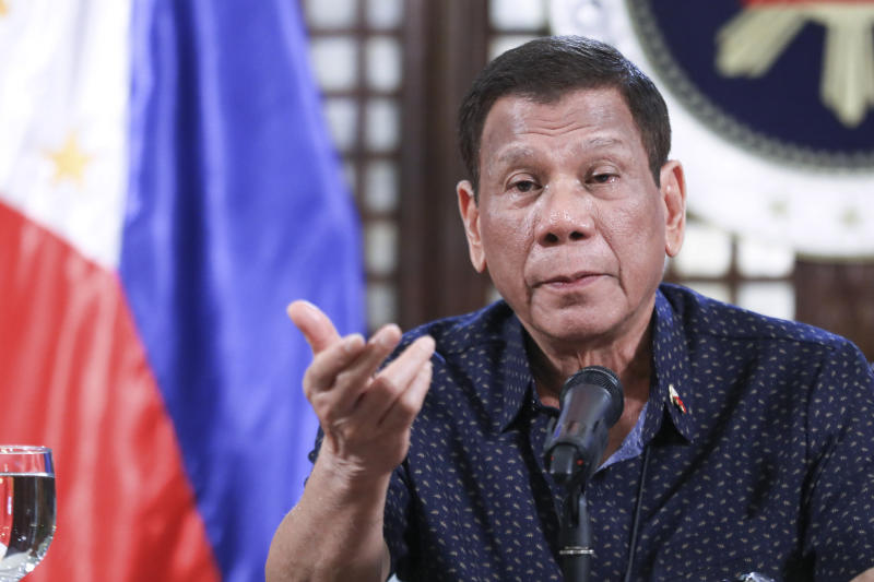 FILE PHOTO: In this handout photo provided by the Malacanang Presidential Photographers Division, Philippine President Rodrigo Duterte speaks on the new coronavirus situation of the country during a late night live broadcast from Malacanang, Manila, Philippines, on Monday April 6, 2020. (Ace Morandante, Malacanang Presidential Photographers Division via AP)