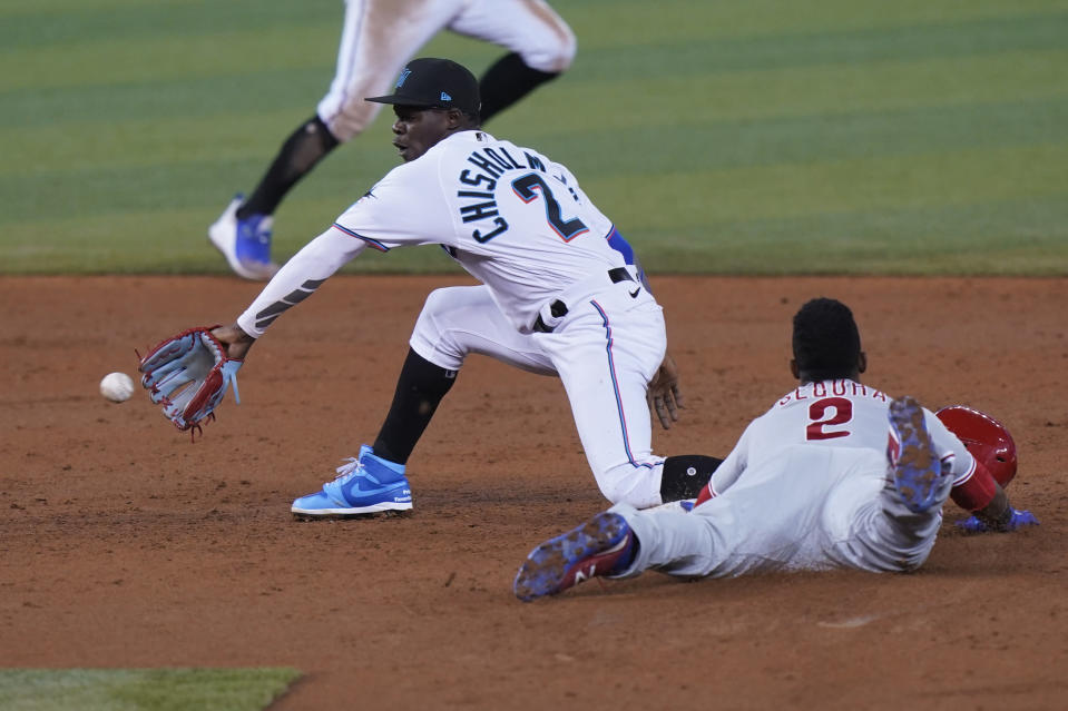 Philadelphia Phillies' Jean Segura, right, steals second base as Miami Marlins second baseman Jazz Chisholm Jr. waits for the throw during the third inning of a baseball game, Monday, May 24, 2021, in Miami. (AP Photo/Wilfredo Lee)