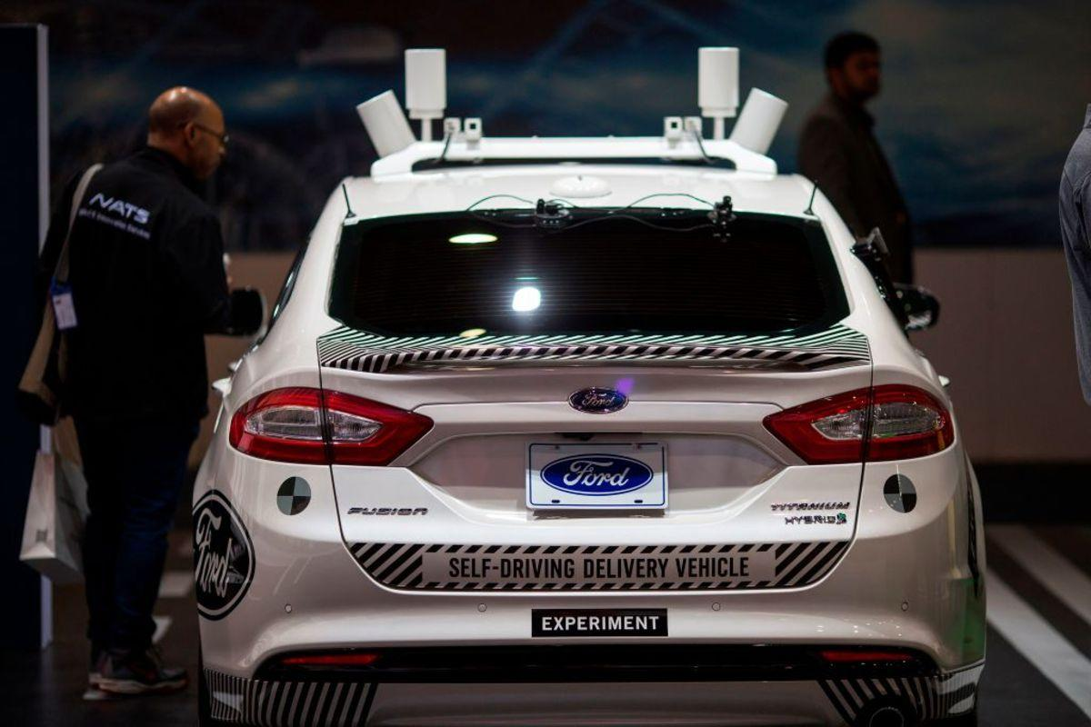 An experimental Ford Fusion self-driving delivery car is displayed at CES in Las Vegas, Nevada, January 12, 2018. / AFP PHOTO / DAVID MCNEW (Photo credit should read DAVID MCNEW/AFP/Getty Images)