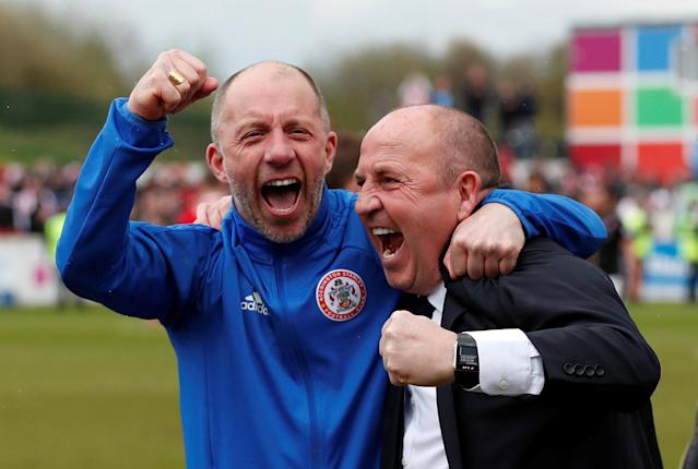 "Soccer Football - League Two - Accrington Stanley v Lincoln City - Wham Stadium, Accrington, Britain - April 28, 2018 Accrington Stanley manager John Coleman (R) celebrates with a member of his coaching team after winning League Two Action Images/Andrew Boyers EDITORIAL USE ONLY. No use with unauthorized audio, video, data, fixture lists, club/league logos or ""live"" services. Online in-match use limited to 75 images, no video emulation. No use in betting, games or single club/league/player publications. Please contact your account representative for further details."