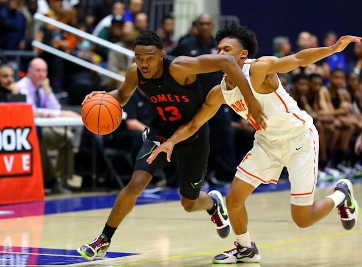 Ky-mani Pollard of Westchester goes by Barry Wilds of Fairfax in Saturday's City Section Open Division final. The Comets gave coach Ed Azzam his 15th City title.