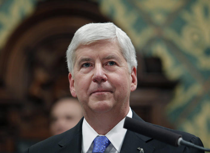 "FILE - In this Jan. 23, 2018, file photo, former Michigan Gov. Rick Snyder delivers his State of the State address at the state Capitol in Lansing, Mich. Snyder says he has turned down a fellowship at Harvard University following social media backlash over his administration's role in the Flint water crisis. He tweeted Wednesday, July 3, 2019, that being a senior research fellow would have been too ""disruptive"" because of ""our current political environment and its lack of civility. (AP Photo/Al Goldis, File)"