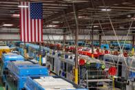 Buses are shown being built at the BYD electric bus factory in Lancaster, California