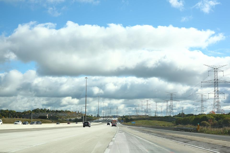 Richmond Hill, Ontario, Canada - October 8, 2016: Clouds over the tall road - highway 407 eastbound in Richmond Hill, Ontario, Canada on a beautiful day in October 2016