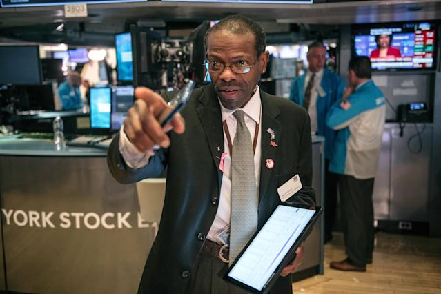 A trader on the New York Stock Exchange floor on Friday, before markets recovered on Monday amid stimulus hopes. (Scott Heins/Getty Images)