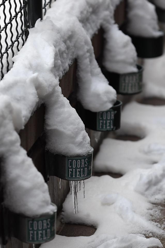 DENVER, CO - APRIL 16: Cup holders are filled with snow as snow removal delays the start of the double header between the New York Mets and the Colorado Rockies at Coors Field on April 16, 2013 in Denver, Colorado. All uniformed team members are wearing jersey number 42 in honor of Jackie Robinson Day. (Photo by Doug Pensinger/Getty Images)