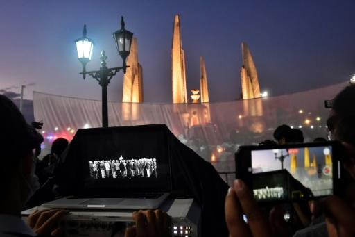 Pro-democracy activists projected footage of the 1932 declaration of the end of absolute monarchy onto a monument in Bangkok