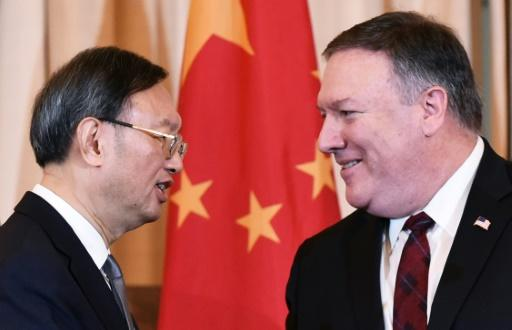 US Secretary of State Mike Pompeo and Chinese politburo member Yang Jiechi shake hands following a press conference in Washington in November 2018