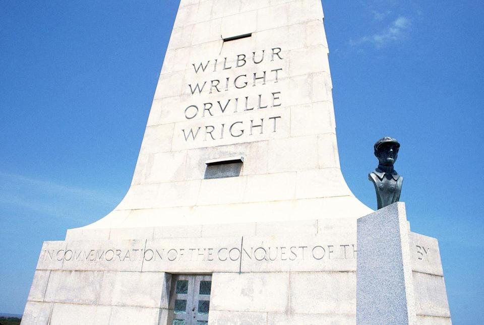 """<p><a href=""""https://www.nps.gov/wrbr/index.htm"""" rel=""""nofollow noopener"""" target=""""_blank"""" data-ylk=""""slk:Wright Brothers National Memorial"""" class=""""link rapid-noclick-resp""""><strong>Wright Brothers National Memorial</strong></a></p><p>It's hard to visualize the distance that Orville and Wilbur traveled during their first attempts at flight — until you stand on this hill in Kill Devil Hills, and see the markers where they landed. Learn more about how they got air travel off the ground at this national memorial in the Outer Banks. </p>"""