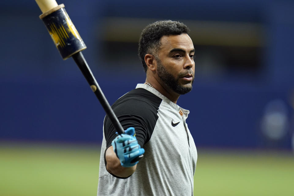 Tampa Bay Rays' Nelson Cruz swings a bat as he waits his turn in the batting cage during an American League Division Series baseball practice Wednesday, Oct. 6, 2021, in St. Petersburg, Fla. The Rays play the Boston Red Sox in the best-of-five series. (AP Photo/Chris O'Meara)