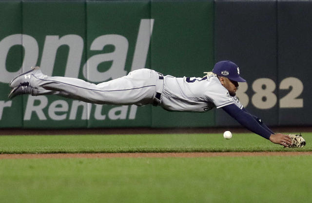 San Diego Padres shortstop Fernando Tatis Jr. dives unsuccessfully for a base hit by San Francisco Giants' San Francisco Giants' Tyler Austin (19) during the fourth inning of a baseball game in San Francisco, Monday, April 8, 2019. (AP Photo/Jeff Chiu)