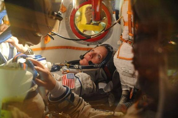NASA's Karen Nyberg sits in the Soyuz spacecraft that is scheduled to launch her and two other astronauts to the International Space Station on May 28. Image released on May 17, 2013