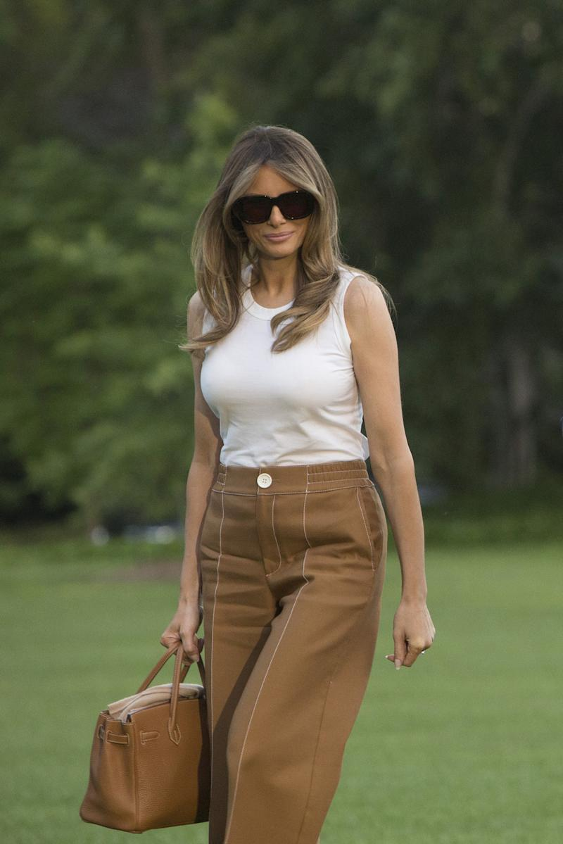 82849a3cca Melania Trump Moves Into the White House in Dolce   Gabbana and Bally