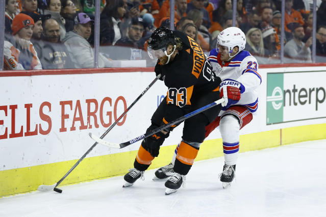 Philadelphia Flyers' Jakub Voracek (93) and New York Rangers' Adam Fox (23) battle for the puck during the second period of an NHL hockey game, Friday, Feb. 28, 2020, in Philadelphia. (AP Photo/Matt Slocum)