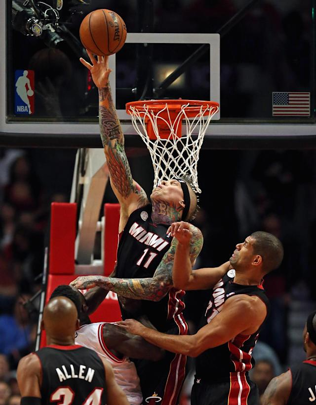 CHICAGO, IL - MAY 10: Chris Anderson #11 of the Miami Heat blocks a shot by Nate Robinson #2 of the Chicago Bulls in Game Three of the Eastern Conference Semifinals during the 2013 NBA Playoffs at the United Center on May 10, 2013 in Chicago, Illinois. NOTE TO USER: User expressly acknowledges and agrees that, by downloading and or using this photograph, User is consenting to the terms and conditions of the Getty Images License Agreement. (Photo by Jonathan Daniel/Getty Images)