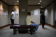 People site and contemplate in a prayer room dedicated to the Tulsa Race Massacre at the First Baptist Tulsa church during centennial commemorations, Sunday, May 30, 2021, in Tulsa, Okla. The church made the room to provide a place to explore the history of the Tulsa Race Massacre of 1921 and to prayerfully oppose racism. (AP Photo/John Locher)