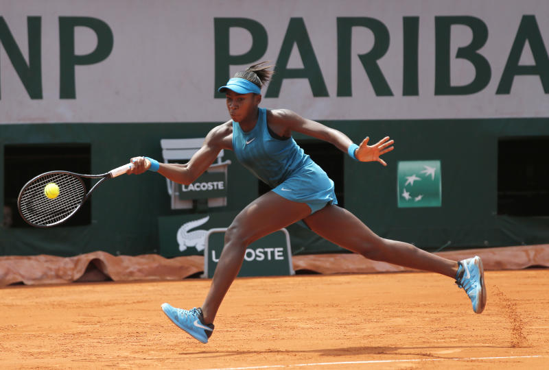 Cori Gauff of the U.S returns the ball to compatriot Caty Mc Nally during their girls' singles final match of the French Open tennis tournament at the Roland Garros stadium Saturday