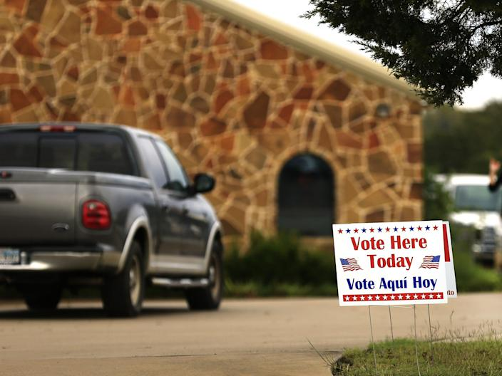 Voters arrive at a polling place to cast their ballots on 8 November, 2016 in Brock, Texas. (Getty Images)