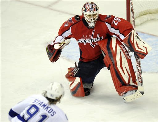 Washington Capitals goalie Tomas Vokoun (29), of the Czech Republic, looks for the puck against Tampa Bay Lightning center Steven Stamkos (91) during the third period of an NHL hockey game, Friday, Jan. 13, 2012, in Washington. (AP Photo/Nick Wass)