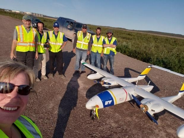 A photo of the crew in Inuvik with the SeaHunter. They spent two weeks taking photos of the Inuvik to Tuktoyaktuk Highway and portions of the Dempster Highway.
