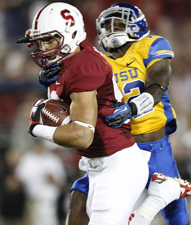 Stanford wide receiver Devon Cajuste (89) scores a touchdown past San Jose State cornerback Forrest Hightower (12) during the first half of an NCAA college football game in Stanford, Calif., Saturday, Sept. 7, 2013. (AP Photo/Tony Avelar)