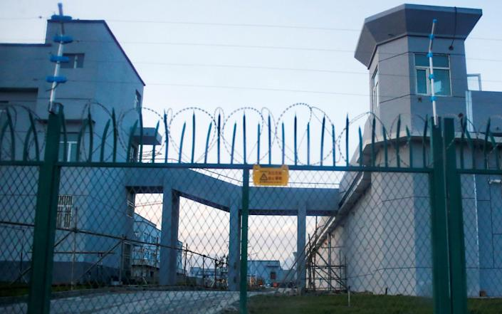 A perimeter fence is constructed around what is officially known as a vocational skills education centre in Dabancheng in Xinjiang - THOMAS PETER/Reuters