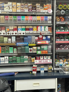 In-store pricing signage for TAAT™ in a tobacco retail shop in its initial market, emphasizing the product's competitive price point of USD $3.99 per pack for Ohio