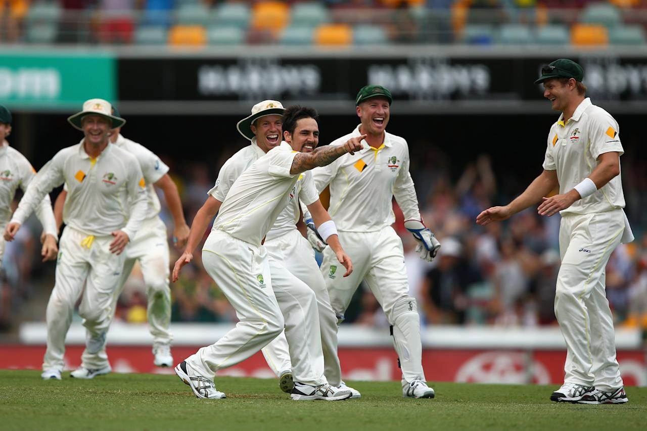 BRISBANE, AUSTRALIA - NOVEMBER 24:  Mitchell Johnson of Australia celebrates taking the wicket of Graeme Swann of England during day four of the First Ashes Test match between Australia and England at The Gabba on November 24, 2013 in Brisbane, Australia.  (Photo by Cameron Spencer/Getty Images)