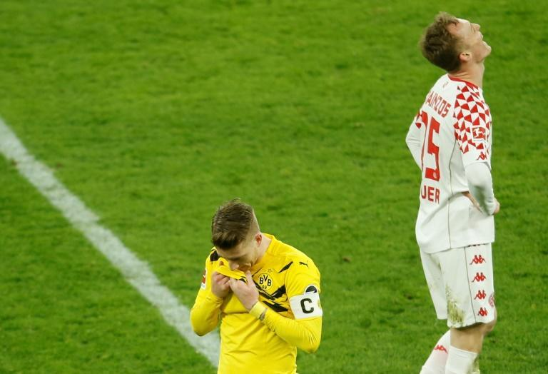 Dortmund captain Marco Reus (L) shows his disappointment at missing a late penalty