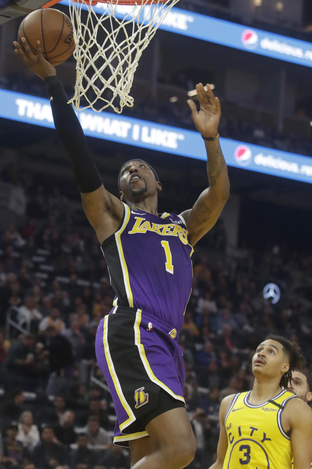 Los Angeles Lakers guard Kentavious Caldwell-Pope (1) shoots over Golden State Warriors guard Jordan Poole (3) during the first half of an NBA basketball game in San Francisco, Thursday, Feb. 27, 2020. (AP Photo/Jeff Chiu)
