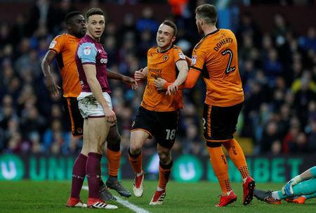 Soccer Football - Championship - Aston Villa vs Wolverhampton Wanderers - Villa Park, Birmingham, Britain - March 10, 2018 Wolverhampton Wanderers' Diogo Jota celebrates with Matthew Doherty after scoring their first goal as Aston Villa's James Chester looks dejected Action Images/Andrew Couldridge
