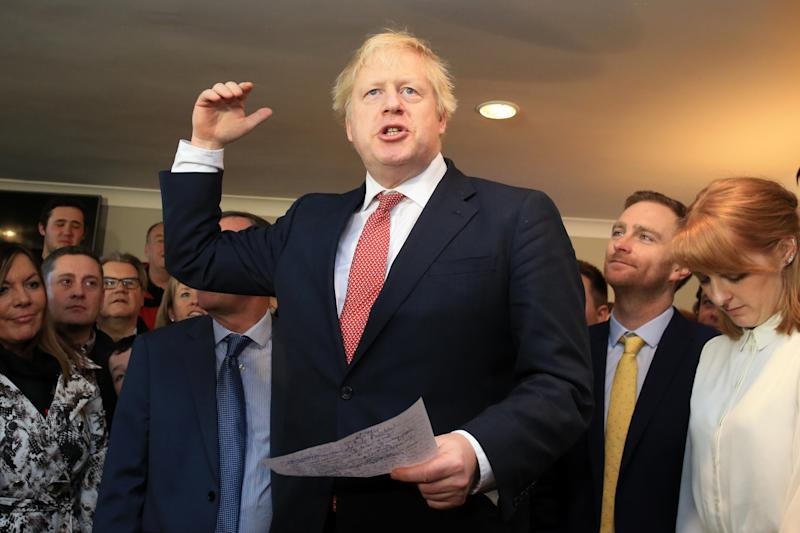 COUNTY DURHAM, ENGLAND - DECEMBER 14: UK Prime Minister Boris Johnson gestures as he speaks to supporters on a visit to meet newly elected Conservative party MP for Sedgefield, Paul Howell at Sedgefield Cricket Club on December 14, 2019 in County Durham, England. Following his Conservative party's general election victory, Prime Minister Boris Johnson called on Britons to put years of bitter divisions over the country's EU membership behind them as he vowed to use his resounding election victory to finally deliver Brexit next month. (Photo by Lindsey Parnaby - WPA Pool/Getty Images)