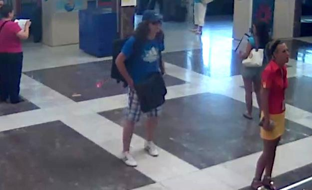 This image taken from security video provided by the Bulgarian Interior Ministry Thursday, July 19, 2012 purports to show the unidentified bomber, center, with long hair and wearing a baseball cap, at Burgas Airport in Burgas, Bulgaria, on Wednesday, July 18, 2012. The brazen daytime bombing that killed seven people and injured dozens on a bus full of Israeli tourists was most likely a suicide attack, Bulgarian officials said Thursday. Israel stood by its claim that Iranian-backed Hezbollah was responsible and vowed to hit back. The identity of the suspected bomber was still unknown but a Michigan driving license that he carried was a fake, Bulgarian Prime Minister Boiko Borisov said. (AP Photo/Bulgarian Interior Ministry)