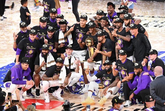 ORLANDO, FLORIDA OCTOBER 11, 2020-Laker players pose for a team photo after winning the NBA championship in Game 6 of the NBA FInals in Orlando Sunday. (Wally Skalij/Los Angeles Times)