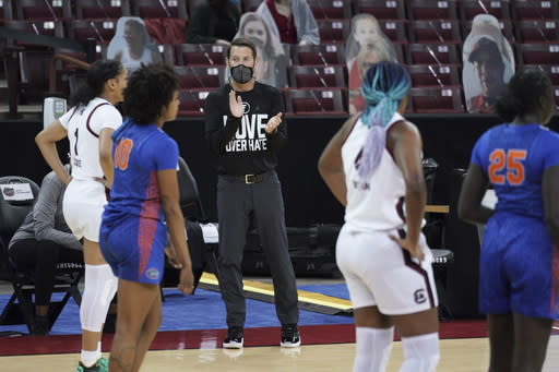 Florida coach Cam Newbauer applauds from the sideline during the first half of the team's NCAA college basketball game against South Carolina on Thursday, Dec. 31, 2020, in Columbia, S.C. South Carolina won 75-59. (AP Photo/Sean Rayford)