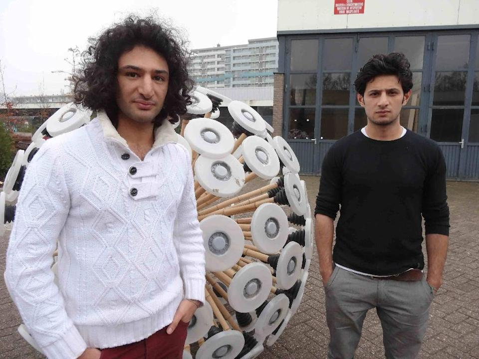"""In 2013, Massoud (L) and Mahmud Hassani won worldwide acclaim for the """"mine kafon"""" -- a giant ball that trips landmines as it rolls around (AFP Photo/Jan Hennop)"""