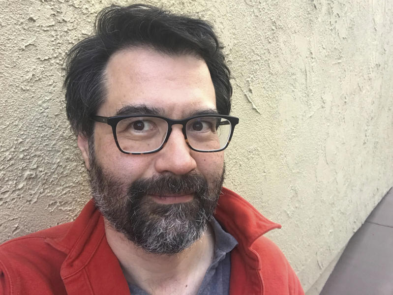 "In this undated photo provided by Greg Pak, Pak poses for a selfie. Pak is co-writer of ""Agents of Atlas,"" a stand-alone, five-part comic book series starting this summer that teams up some of Marvel's mightiest Asian and Asian American superheroes. (Greg Pak via The AP)"