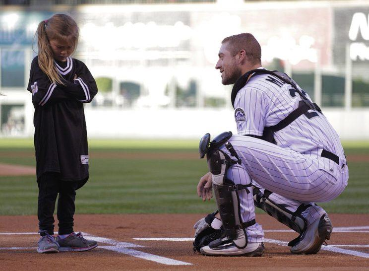 DENVER, CO - SEPTEMBER 17: Tom Murphy #23 of the Colorado Rockies talks to a young girl during activities before the Rockies game against the San Diego Padres at Coors Field on September 17, 2016 in Denver, Colorado. (Photo by Joe Mahoney/Getty Images)