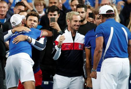 Tennis - Davis Cup - World Group Semi-Final - France v Spain - Stade Pierre Mauroy, Lille, France - September 14, 2018 France's Benoit Paire celebrates with teammates after winning his match against Spain's Pablo Carreno Busta REUTERS/Benoit Tessier